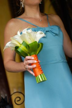 white calla lilly bouquet, orange fabric wrapped around stems with a bow, teal dresses - not aqua blue