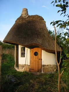 Exteriors: Cob house, Denmark - link includes a story of how the house came to be and materials and time it took to build, Use the translate bar for English.