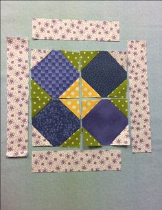 corners pressed open  Step 6: Press the corners away from the center of each block. Then carefully layout the four squares so they are arranged as shown in the photo.