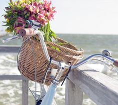 Bicycle at the seaside and ... with flowers.