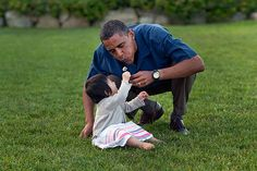 President Barack Obama plays with his niece Savita during the family's vacation on Martha's Vineyard, Aug. 25 2009. (Official White House Photo by Pete Souza)