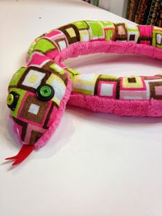 Free stuffed snake pattern and tutorial. Maybe a doorstop or a dress up costume prop.
