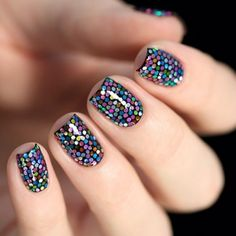 Lovely sequin nails on black.