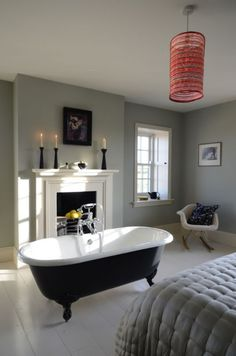 a fireplace next to a bathtub makes so much sense, i dont' know why you don't see them more often.