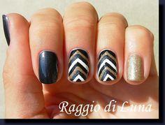 http://raggio-di-luna-nails.blogspot.com/2014/11/black-grey-white-golden-reverse-chevron.html