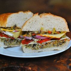 vegetarian muffaletta recipe. if you're grilling or have other veg on hand, sub a big portobello and some roasted bell peppers for the sun-dried tomatoes and artichokes here.