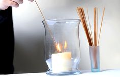 Use a piece of spaghetti to light nearly burnt out candles