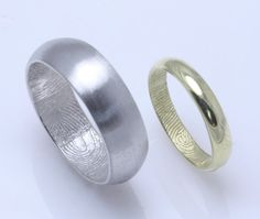 aaaaah i want this! simple wedding bands with my fingerprint inside his and his fingerprint inside mine!