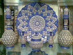 """Vitreous enamel(Mina Kari) 2,is a material made by fusing powdered glass to a substrate by firing, usually between 750 and 850 °C (1,382 and 1,562 °F). The powder melts, flows, and then hardens to a smooth, durable vitreous coating on metal, or on glass or ceramics. The term """"enamel"""" is most often restricted to work on metal, which is the subject of this article. Enameled glass is also called """"painted"""". Fired enamelware is an integrated layered composite of glass and metal,Isfahan,Iran"""
