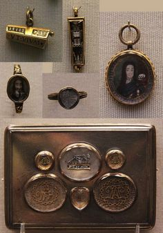 """""""Memento Mori"""" coffin pendants 16c, Stuart memorial jewellery 1660-1714 Charles I's miniature portrait, Charles II memorial rings 1684, Silver box with memorial jewels— Five of the jewels with monograms in gold wire; one with a skeleton and MEM.MOR (memento mori: remember that you must die). The memorials late 17th or early 18th c, set in an 18th-century box."""