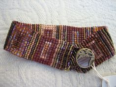 Loom Woven Rectangle Bracelet in Peaches and Mauves with Vintage Button Closure. $40.00, via Etsy.