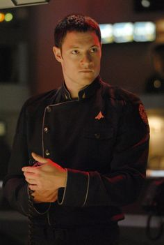 "Agathon is an Electronic Countermeasures Officer, part of a two-person Colonial Raptor crew based on the Battlestar Galactica, and is paired with Sharon ""Boomer"" Valerii before the Cylon attack on the Twelve Colonies. Unlike other major characters such as Kara ""Starbuck"" Thrace or Gaius Baltar, the series reveals little about Agathon's life before the events of the series. It is confirmed Helo is a Caprican, which is partly why he and Starbuck knew each other."