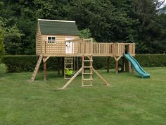 A Miniature Manors wooden play area, complete with a climbing wall, slide, swings and a secret trap door for games of hide and seek!
