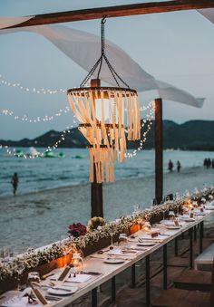Destination Thailand wedding, beach reception and chandelier