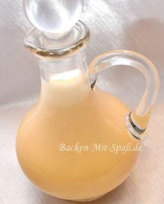 Eierlikör Zutaten: 1 Vanilleschote 1 Orange 400ml Milch 250g Zucker 8 Eigelbe 250ml weißer Rum (54%, bei mir 37,5%)
