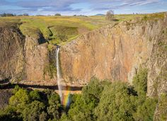 My first successful attempt at hiking to Phantom Falls in North Table Mountain was a satisfying one. The falls had ample waterflow, and I was rewarded with a rainbow caused by the wind-blown spray and the afternoon sun. The rainbow appeared to be rising from the tree canopy below, and disappeared soon after when the sun dipped behind a cloud. The waterfall is 164 feet high and runs off the edge of Coal Canyon, in front of a grotto.