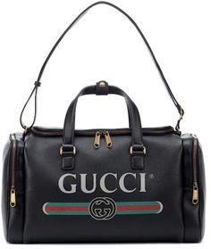 b9996e1430f9 Gucci Print leather travel bag