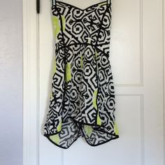 Geo printed strapless romper A super cute strapless romper, featuring a back and white pattern, with bright yellow splashes of color. Reverse Other