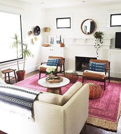"#OKLStyleTip from @carpendaughter and her fresh boho living room: ""It's all about the mix! Layering a bright pink Turkish rug with a less expensive jute rug allowed me to cover more space and add texture."" Thanks for sharing your snap! ✨Check out the link in our profile to shop her entire look.✨ #regram"