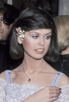 This 1977 picture from the American Music Awards shows her rocking head-to-toe lavender. To get Marie's monochromatic look try a soft purple eye shadow that coordinates with a fun floral hair accessory and jewelry. To keep the focus on your eyes keep your lips subtle with a neutral shade of lipstick.