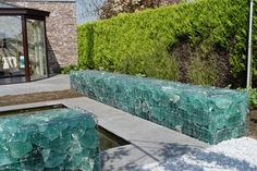 I'm now fascinated with gabion. This one uses slag glass which can be lit from behind.