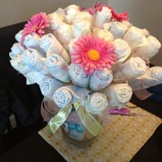Great alternative to a diaper cake...made this diaper bouquet for a co-worker by Aamse