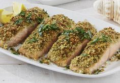 Herb Crusted Salmon Fillet Method  Preheat oven to 205 degrees. In a small bowl, combine melted butter, breadcrumbs, parsley, chives, and cheese. Season to taste with salt and pepper. Season salmon with salt and pepper, then spread 1/2 tablespoon of the mustard over the flesh sides of each fillet. Coat with the breadcrumb and herb mixture. Place salmon, skin-side down, into a lined baking tray. Drizzle with remaining oil and bake for 10-15 minutes until crust is golden and fish is cooked…