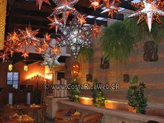 Recreate Los Cebollines restaurant decor by putting up various star lanterns in patio