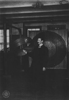 "March, 1899-Tesla demonstrates ""wireless"" power transmission in his Houston…"