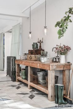 Entrance with reclaimed wood table