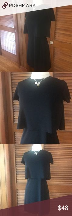 EUC BAILEY 44 BLACK SPLIT BACK LBD WORN ONCE THIS DRESS BY BAILEY 44 IS A FABULOUS GO TO LBD. Looks like a skirt with Loose short sleeve tee over it - but it's all one piece - turn around and the back demurely slits open. ITS JUST THAT SUBTLE SEXY AND THE JERSEY MATERIAL MAKES IT PERFECT FOR DRESS UP OR CASUAL- YOU CAN EVEN WEAR IT FOR WORK BECAUSE ITS SO SUBTLE! ABSOLUTELY LOVE THIS DRESS AND THE PRICE FOR A PRACTICALLY NEW BAILEY DRESS IS INSANE!! COME ON SOME ONE ENJOY THIS DRESS!! Bailey…