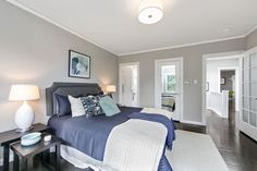 Contemporary Guest Bedroom with French doors, flush light, Crown molding, Hardwood floors, Taylor Linens Hudson Matelasse