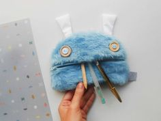 Monster coin purse with furry skin. Zé coin glutton: designed and handmade in Porto, Portugal.