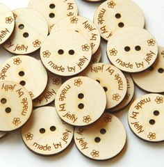 These wooden buttons are great for your own products. Price includes 18 identical buttons  Buttons measure 0.75 in diameter and they can contain your shop name, laser etched on solid maple, cherry or walnut wood . You can also choose to include little symbols, like stars, hearts or flowers.  Please send us an email with any requirements or questions you might have, and we will be glad to help you.  Most custom orders will be ready to ship within 2 days.  IMPORTANT: Wood buttons should never…