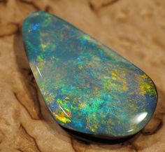 9.4 cts Very rare black opal from Andamooka  BLACK OPAL FROM LIGHTNING RIDGE NEW SOUTH WALES AUSTRALIA FROM OPALAUCTIONS.COM