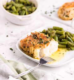 Pan Fried Garlic Butter Cod is light, flaky and tender. This cod is made in a skillet and pan fried with garlic and butter until there is a crispy outer skin. You will love how easy this comes together! // acedarspoon.com #cod #panfried #seafood #mediterraneandiet