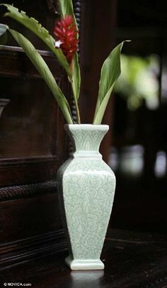 Celadon ceramic vase, 'Forest' by NOVICA. $204.95. Features a crackled finish. A fair trade product. Watertight. Handmade by Thatsanee and Ramphan. Normally ships directly from Thailand within 10 days.. NOVICA, in association with National Geographic, searches the world to work directly with the finest artisan designers. Impressive in its structure, alluring in its delicacy, this vase stands like a proud column adorned by an abundance of floral grandeur. The design comes ...