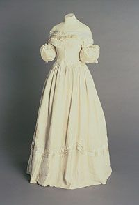 Woman's Dress Made in United States 1829 Artist/maker unknown, American. Worn by Mrs. Henry (Charlotte) D. Mandeville. Ivory silk Center Back Length: 49 3/16 inches (125 cm) Waist: 22 7/16 inches (57 cm) Bottom Edge Circumference: 114 3/16 inches (290 cm)