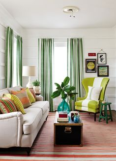 If you like a bold pattern, you don't have to limit yourself to one attention-grabbing accessory. In this living room, stripes are the ties that bind.