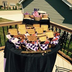 Candy buffet and thank you baskets with split champagne bottles, champagne flute with fresh strawberries in the glass.
