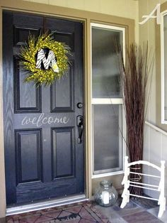 Front door with vinyl lettering, great idea, and not permanent if you don't like it or get tired of it. Also can be done on glass of screen door.