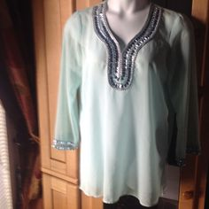 "Adrienne Vittadini Sheer Tunic Top Preowned Adrienne Vittadini sheer tunic to0 with rhinestone from trim. Color: mint green. Rhinestones around the sleeves as well (see pics)"""" slits on the sides for more comfort. Adrienne Vittadini Tops Tunics"