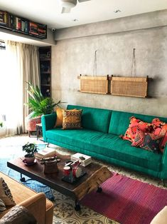 The Thakurs' Colorful Home Is an Ode to Rich Fabrics and Patterned Floors A Goa-Inspired Home in Mumbai designed by PS Design, an interior designer in Mumbai. This home uses patterened floors and rich fabrics. Home Decor Furniture, Home Decor Bedroom, Living Room Decor, Sofa Design, Indian Interior Design, Indian Interiors, Indian Living Rooms, Interior Exterior, Diy Interior
