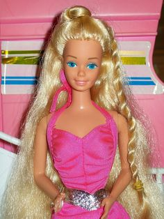 I had Twirly Curls Barbie and used the 'twirly machine thingie' to twirl my own hair and the manes and tails of My Little Ponys.  My brother had Action Men and we sometimes played together!