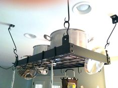 Hey, I found this really awesome Etsy listing at http://www.etsy.com/listing/69342762/hand-forged-small-pot-rack-with
