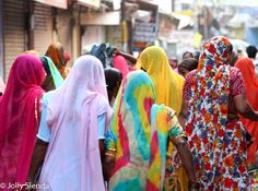 Backs of women wearing saris on the street, Pushkar, India. Photo by Jolly Sienda Photography.