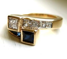 Diamond and Blue Sapphire Bypass 1.55ct Anniversary Engagement Ring 14kt Yellow Gold High Quality VS Diamonds. $1,199.00, via Etsy.