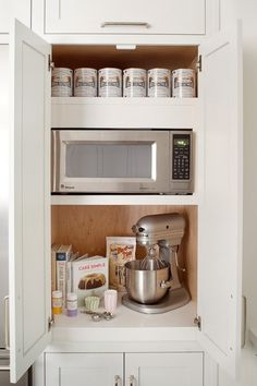 hidden microwave and stand mixer in cabinet. Just add slides to the mixer platform and you can pull it out when in use.