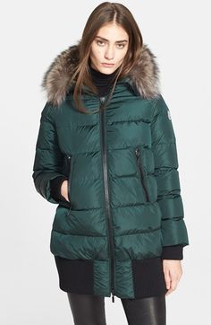 Soft raccoon fur trims the hood of a cozy, down-insulated parka designed for the coldest days, when you need extra protection from head to thigh. Rib-knit cuffs and a wide band of ribbed trim at the hem help keep the chill wind out.