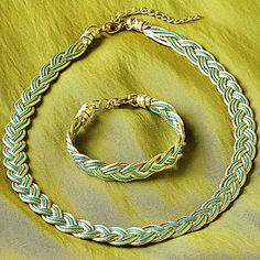 An Aegean Romance. In this romantic Athena Braid Necklace and Bracelet American artist Stelios Paraskevas meticulously weaves 24k gold-plated strands of copper with leather. Gold-plated findings. Lobster clasps. Handmade in the U.S.A.